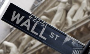 "Photo of Wall Street sign for the ""Is the stock market rigged?"" article."